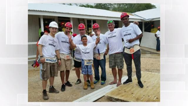 Dr. Marjorie Dixon and her son help build a school in Jamaica