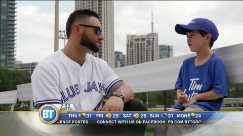 Jays player Kevin Pillar talks with 6-year-old Aaron